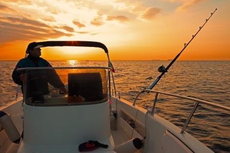 fisherman in bay boat at dawn