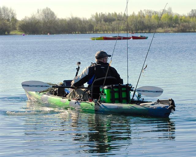fisherman in kayak - malone kayak trailer
