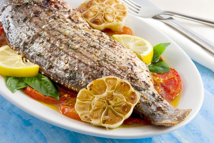 roasted striped bass dish