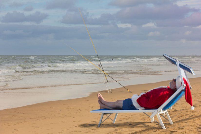 santa claus on vacation surf fishing