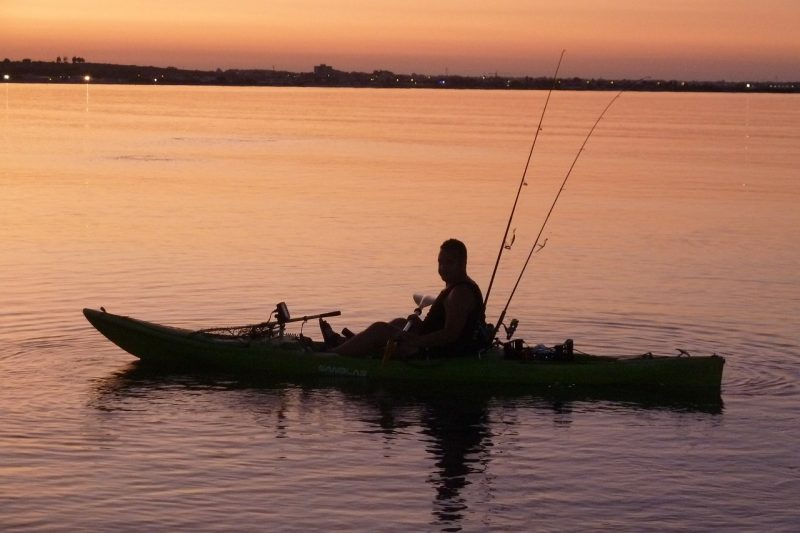 man fishing in kayak