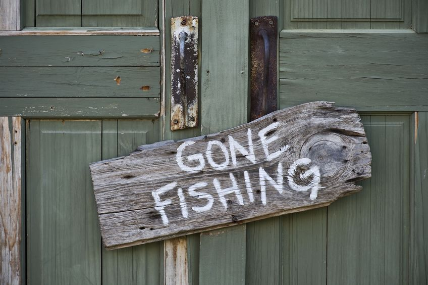 gone fishing sign on door