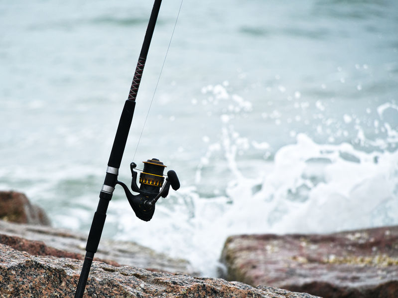 spinning reel and rod on jetty