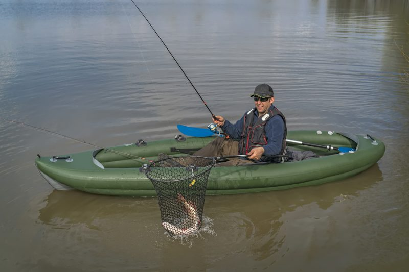 kayak fisherman with big illinois pike